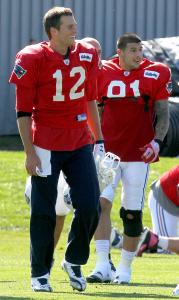 Tom Brady (left) had Aaron Hernandez at his side during practice yesterday.