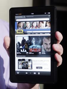 While the Kindle Fire may drive holiday shoppers to stores, the device's freebies from Amazon may lure customers away.