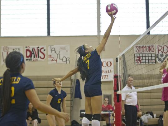 Lynnfield High senior middle hitter Liz Vo clears the net during a game against Masconomet High School at Masconomet on Thursday.