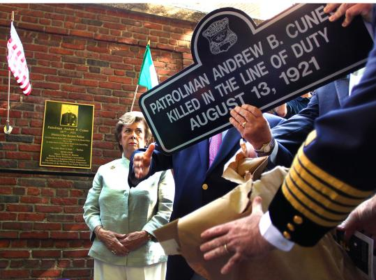 City officials dedicated a memorial in honor of Boston patrolman Andrew Cuneo, the first Italian-born Boston policeman, and the first to be killed in the line of duty. A copy of a street sign that is in place now on Hanover Street, where Cuneo was shot, is given to Cuneo's grandaughter, Barbara Cuneo O'Connell.