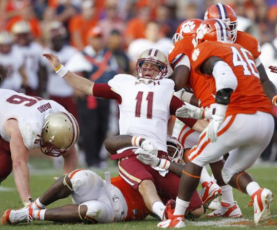 BC quarterback Chase Rettig had another rough day, including when he got crunched by Clemson defensive end Andre Branch.