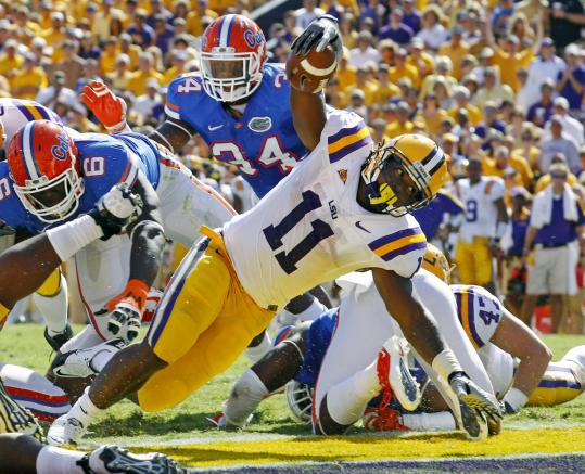LSU running back Spencer Ware dives for a touchdown during top-ranked LSU&#8217;s win over 17th-ranked Florida.