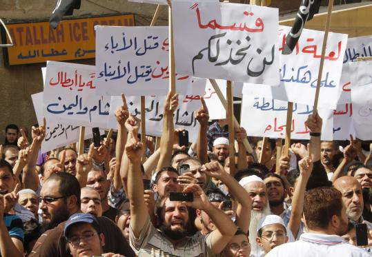Protesters against the Syrian regime shouted slogans in the southern port city Sidon, Lebanon.