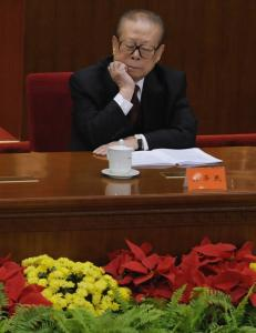 Former president Jiang Zemin listened to a speech by the current president, Hu Jintao, yesterday in Beijing, raising health questions.