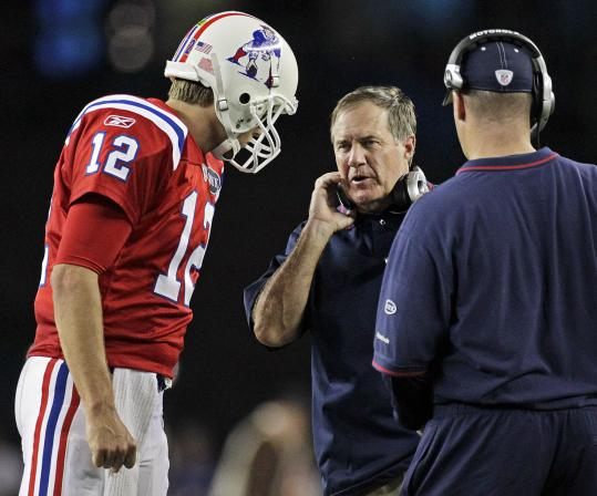 Bill Belichick talks with Tom Brady during the final Patriots drive, which ended in a field goal that wrapped up the contest.