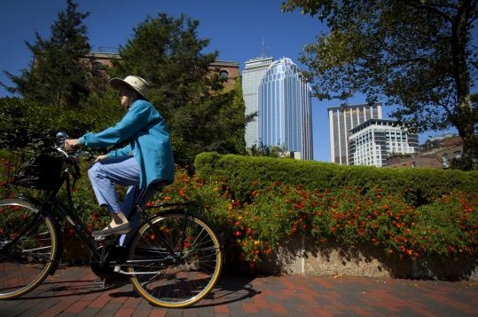 A woman rode her bike through the Southwest Corridor, one of Boston's largest and most prominent public spaces.