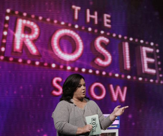 In the monologue of her first show, Rosie O'Donnell praised her new boss Oprah Winfrey and hoped she wouldn't do anything to upset the Mighty O.