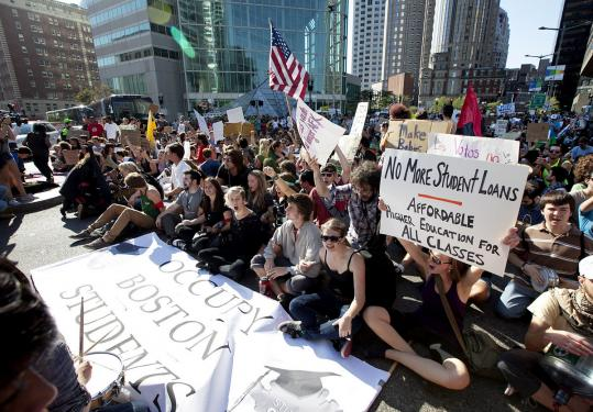 Occupy Boston students stopped in Dewey Square yesterday to sit and protest before marching to the Charlestown Bridge.