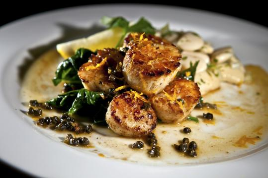 Top: Seared scallops served with spinach and a salad of celery and heirloom beans. Above: Roast chicken with gravy, mashed potatoes, and broccoli rabe.