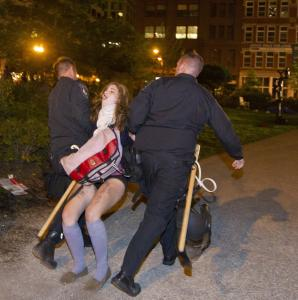 A protester was dragged away as Boston police broke up a demonstration on the Rose Fitzgerald Kennedy Greenway.