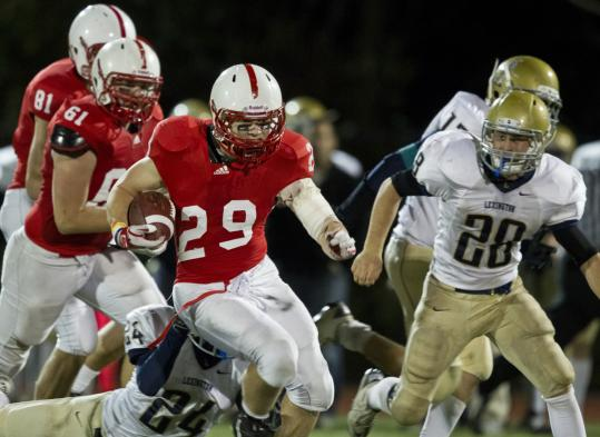 Melrose High running back Spencer Walsh breaks away during the fourth quarter last Thursday.
