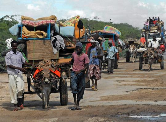 Residents used donkey carts to flee fighting between Somalia's government forces and Al Shabab insurgents in Mogadishu.