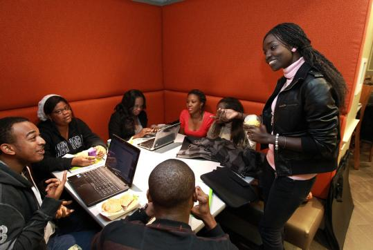 Therese Mbaye (right) and other former students at Suffolk's Dakar campus now study at the Boston campus.