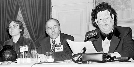 Barbara Gittings, Frank Kameny (center), and Dr. John Fryer, disguised as Dr. H. Anonymous, at the American Psychiatric Association's annual conference in 1972. Their actions led the APA to remove homosexuality from its list of mental illnesses.
