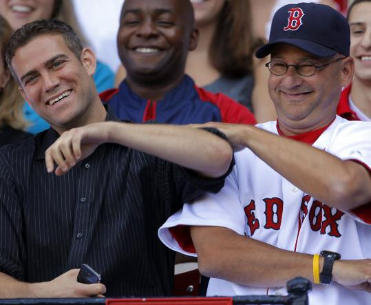Theo Epstein and Terry Francona had a light moment during the team picture in August (before the bottom fell out).