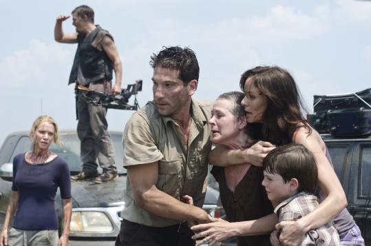 "From left: Laurie Holden, Norman Reedus, Jon Bernthal, Melissa Suzanne McBride, Sarah Wayne Callies, and Chandler Riggs are human survivors among the zombies in ""The Walking Dead.''"