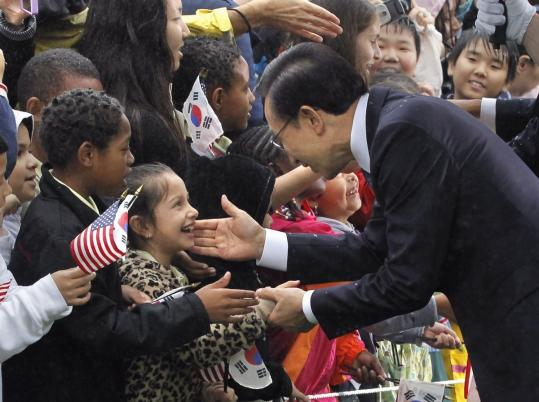 WARM WELCOME - South Korea's president, Lee Myung Bak, greeted schoolchildren during a state arrival ceremony at the White House yesterday. President Obama later held a news conference with Lee and praised a trade deal between their two countries that was approved by Congress this week. Political Notebook, A9.