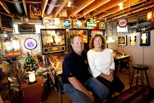 Retired Raynham electrician Joe Fix and his wife, Cheryl, have turned over their basement to his array of restored pinball machines and vintage signs.