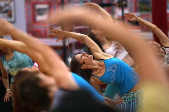 Melinda Pavlata teaches a class at the Moody Street Circus, a performing arts studio in Waltham that she oversees with her husband, Sacha.
