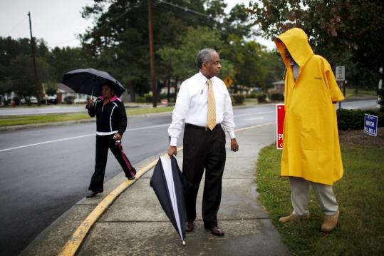 Mayor William Bell, shown talking with voters as he exited a Durham polling station last week, was the first black mayor in North Carolina to publicly endorse President Obama in 2008.