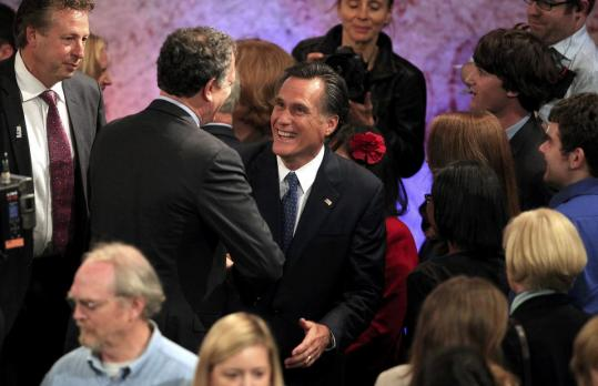 Former Massachusetts governor Mitt Romney spoke with audience members after a GOP debate in New Hampshire last week.