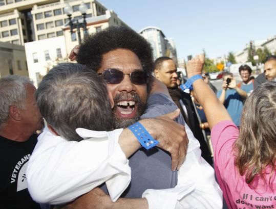 Princeton University professor and activist Cornel West was hugged outside Superior Court in Washington, D.C., yesterday.