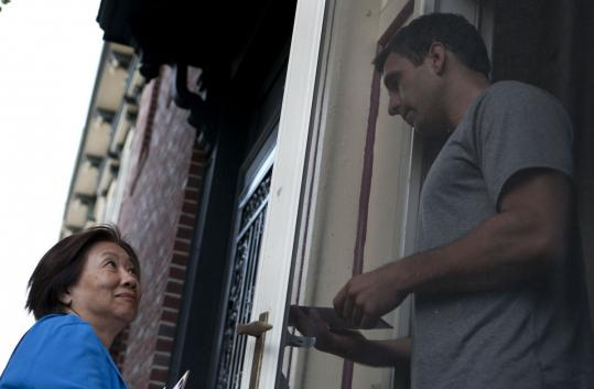 City Council candidate Suzanne Lee talked to David Anderson as she canvassed in South Boston last week.