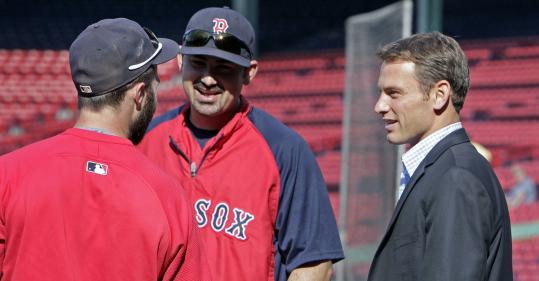 Is Padres GM Jed Hoyer (right, with Dustin Pedroia and Adrian Gonzalez) a future Cub, too?