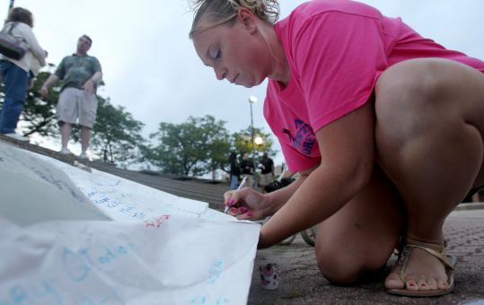At a vigil held in August at Brockton City Hall, Christina Allen of Brockton signed a poster remembering those who have died of drug overdoses.