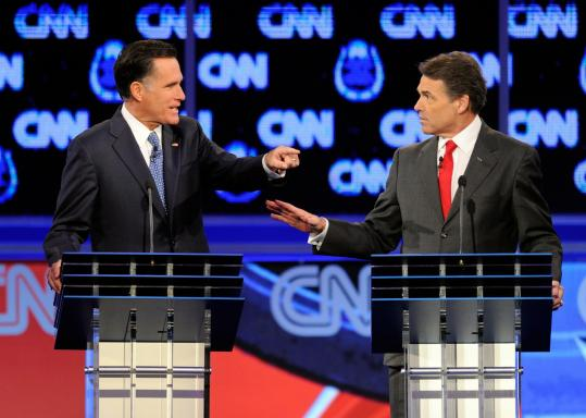 Former governor Mitt Romney of Massachusetts and Governor Rick Perry of Texas went toe-to-toe on illegal immigration at Tuesday night's GOP debate in Las Vegas.
