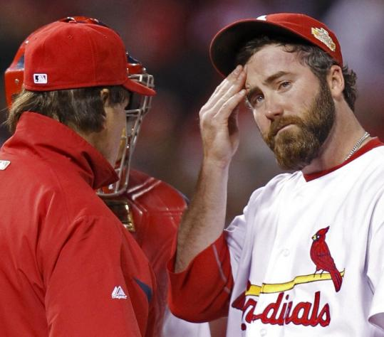 Cardinals closer Jason Motte got pulled by Tony LaRussa after putting the first two Texas batters on in the ninth inning.