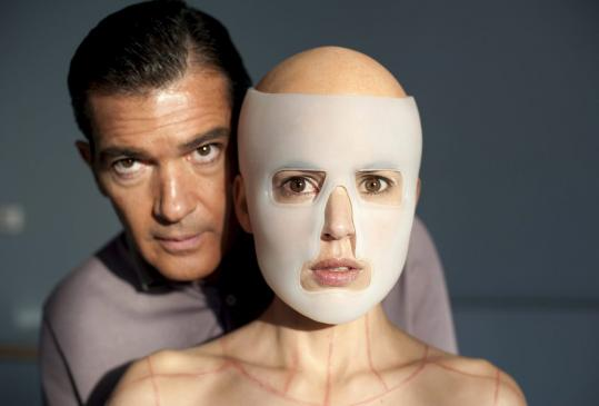 "Antonio Banderas and Elena Amaya in a scene from ""The Skin I Live In.'' Banderas plays a plastic surgeon who inwardly morphs into a vengeful monster."