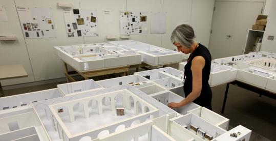 Above: Models of the Harvard Art Museums' future galleries are housed in a former factory building in Somerville, where staff meet and discuss the placement of paintings and sculptures. Below: A model of the new complex, set to open in 2013, shows the view from Broadway and Quincy Street. A photo taken from Prescott Street shows the renovation and expansion in progress.