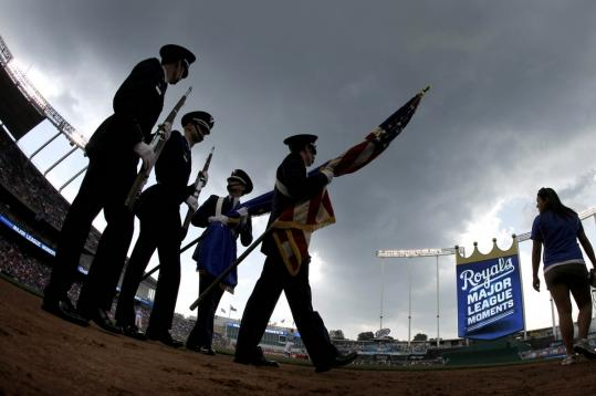 A color guard from the University of Kansas ROTC walks off the field at a Kansas City Royals game in May.