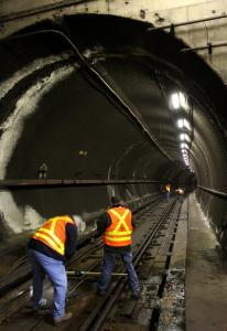 MBTA workers checked Red Line tracks at Davis station after leaks were discovered in the tunnel ceiling.