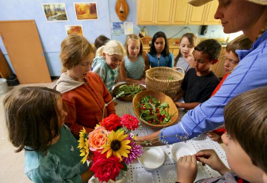 Anastasia Sinclair, a gardening teacher, showed third-graders how to make a salad from vegetables grown at the Los Altos Waldorf School, where lessons are hands-on.