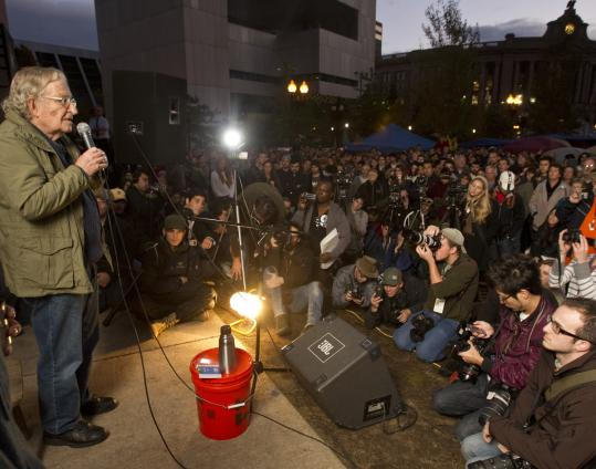 Noam Chomsky spoke at Occupy Boston&#8217;s &#8220;Free School University&#8217;&#8217; in Dewey Square last night. He encouraged Bostonians to work together to achieve the changes they seek.