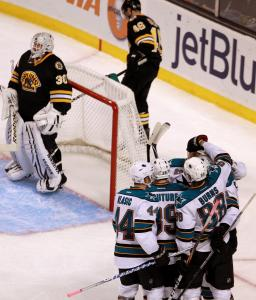 Tim Thomas and David Krejci don't look as the Sharks circled after Logan Couture's strike.