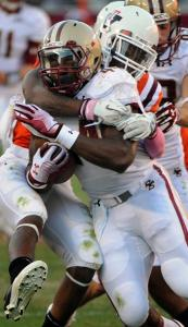 BC running back Andre Williams has nowhere to run with Eddie Whitley wrapped around him.