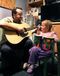 Dana-Farber music therapist Brian Jantz with Phoebe Davis, 4.