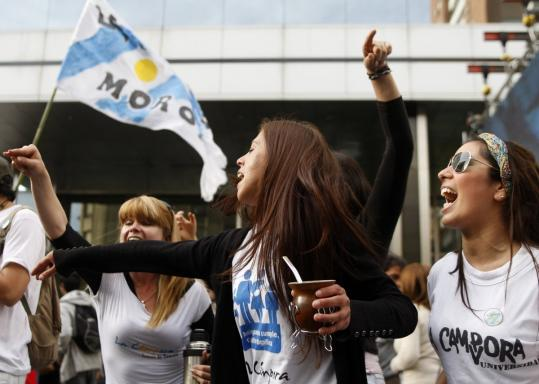 Supporters of President Cristina Fernandez celebrated her landslide reelection victory yesterday in Buenos Aires.