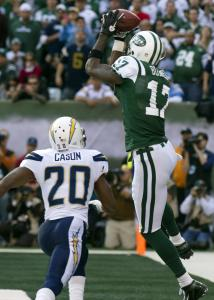 Plaxico Burress snags the third of his three TD catches. The Jets receiver finished with four receptions for 25 yards.