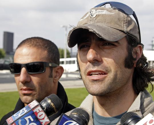 IndyCar drivers Dario Franchitti (right) and Tony Kanaan discussed was to make open-wheel racing safer.