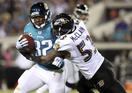 The Jaguars' Maurice Jones-Drew wasn't easy for linebacker Jameel McClain and the Ravens to bring down, rushing for 105 yards.