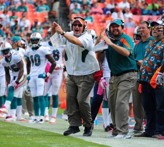 Time is likely running out for coach Tony Sparano (left), whose Dolphins lost in spectacular fashion to the Broncos.