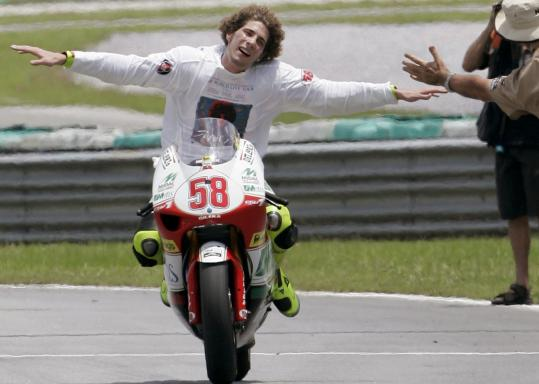 In Malaysia, Marco Simoncelli celebrated after clinching the 250cc Championship title in 2008.