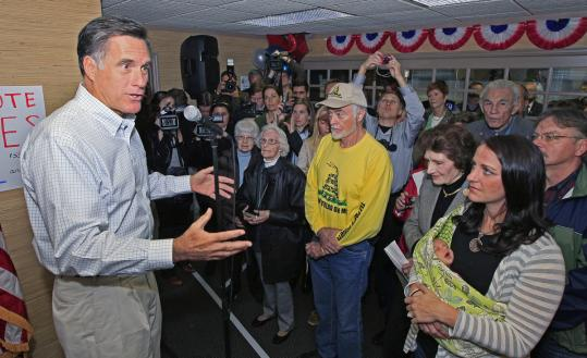 Mitt Romney, shown in Ohio yesterday, believes each state should pursue its own health care plan, an adviser said.