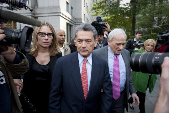 Rajat Gupta, a former Goldman Sachs and Procter & Gamble director (center), was indicted in federal court in New York yesterday on charges of conspiracy and securities fraud.