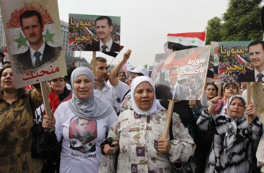 A rally in Damascus supported Syria's President Bashar Assad before an Arab delegation urged him to end the nation's strife.