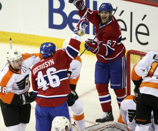 The Canadiens' Andrei Kostitsyn (left) celebrates with Max Pacioretty (67), who scored twice as Montreal routed the Flyers.